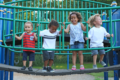 group of children are playing together on the playground