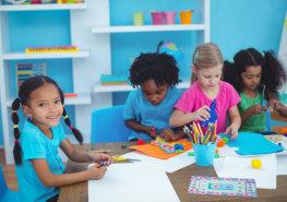 Four kids doing their art work