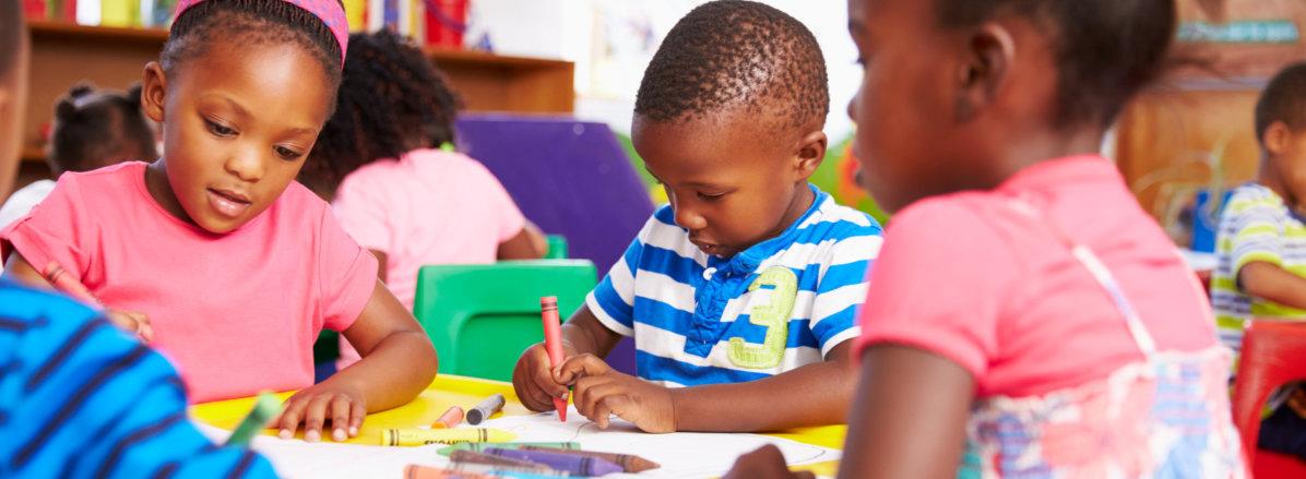 Children holding a crayon