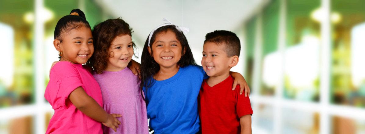 Four kids laughing